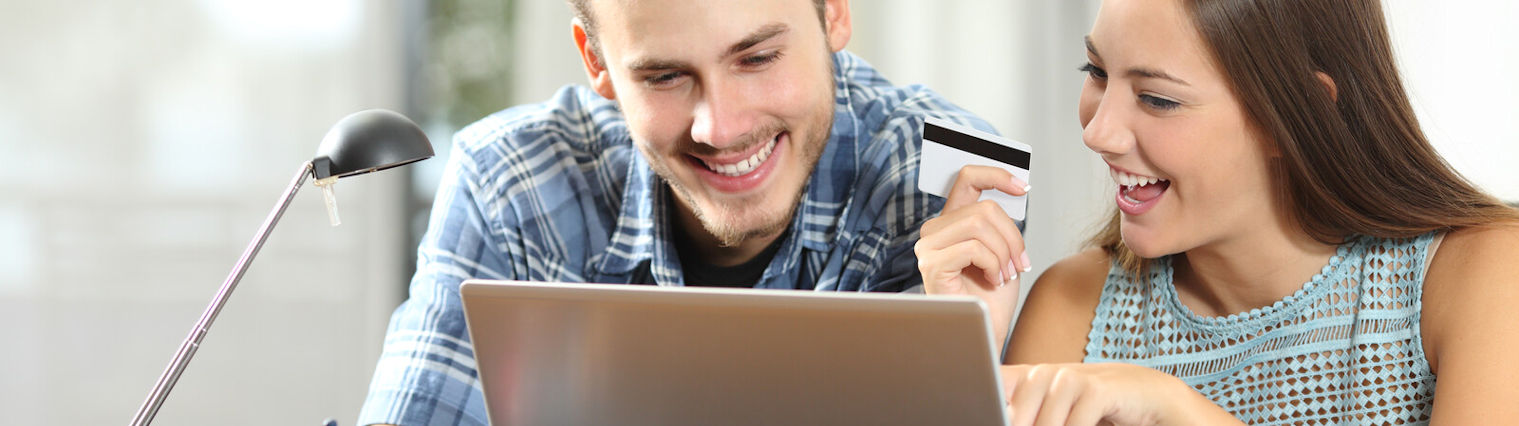 Couple making an online purchase with a card.